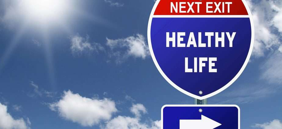 """interstate highway sign saying """"next exit: healthy life"""" with arrow pointing right"""