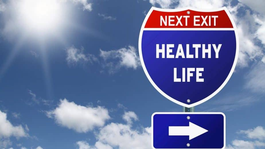 "interstate highway sign saying ""next exit: healthy life"" with arrow pointing right"